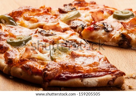 Pizza with cheese ham and jalapeno pepper