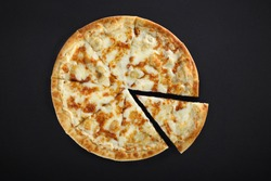 Pizza with cheese on a black background. Khachapuri