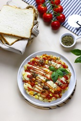 Pizza with cut fresh bread.  Add beaten egg and topped with spaghetti sauce, sausage, a mixture of vegetables and mozzarella cheese on bright foodphotography