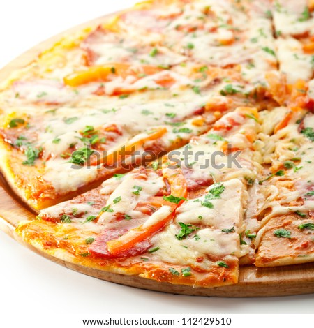 Pizza with Ham, Salami, Tomatoes and Mozzarella Cheese
