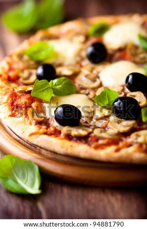 Pizza with mozzarella and mushrooms