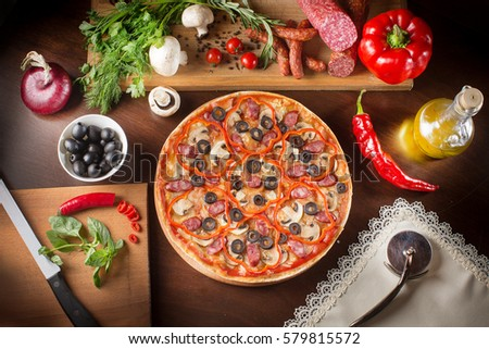 Pizza with mushrooms black olives onions green pepper isolated on white background. Pizza with olives, tomato cherry, onion. Top view. Fresh italian pizza. Pizza with cheese ham peppers olives board