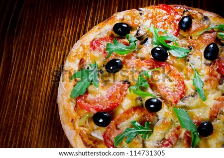 pizza with mushrooms, tomatoes, olives
