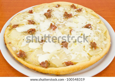 pizza with potatoes and sausage in pieces