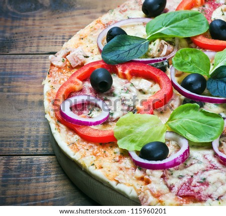 pizza with salami, olives and cheese cut into chunks