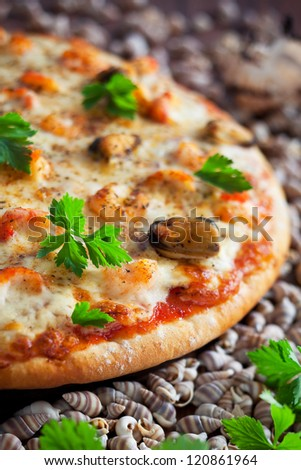 Pizza with seafood and spicy sauce, selective focus