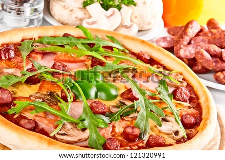 Pizza with tomato, salami and mushrooms