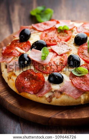 Pizza with tomatoes and salami