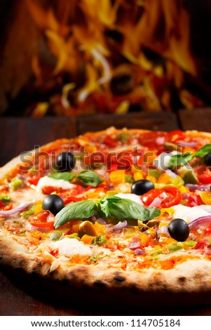 pizza with vegetables and green basil