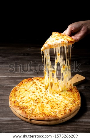 Pizza with very much cheese melting