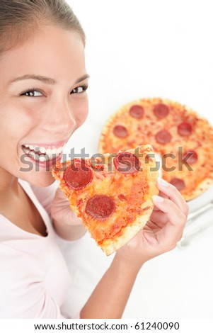 Pizza. Woman eating pizza happy smiling looking at camera.