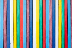 Placard of colorful  wooden planks as background . Full frame shot of multi colored wall .