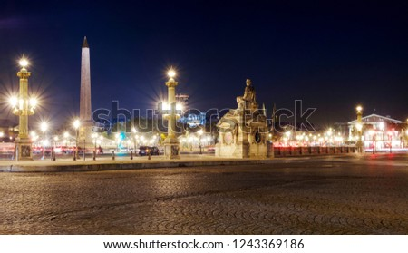 Place de la Concorde lit by lanterns at night, Paris, France #1243369186