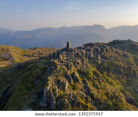 place fell at sunrise with Helvellyn massif in the background. lake district national park