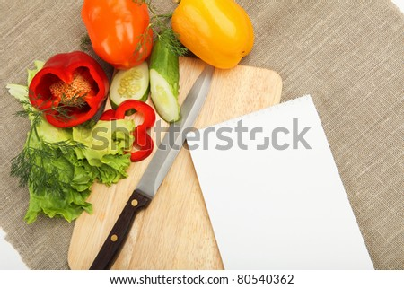 Place for cooking vegetables, vegetables, and a notebook. symbol of a healthy lifestyle.