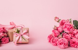 Place for product display place with empty, promote products design on soft pink pastel background with roses and gifts