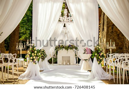 Place for wedding ceremony in white color ,with white fireplace