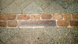 Place of the Berlin wall until 1989, remained foundation of the wall with information as part of a street near Checkpoint Charlie was a Berlin Wall crossing point between East and West Berlin, Germany