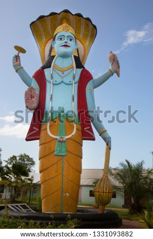 Place of worship for hindu, with spiritual items like flags, statues and symbols room for sacrifice and meditation  #1331093882