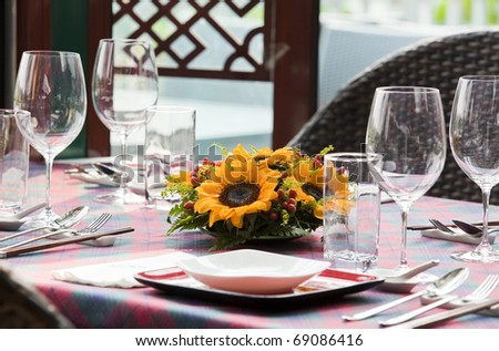 place setting at laid restaurant banquet table