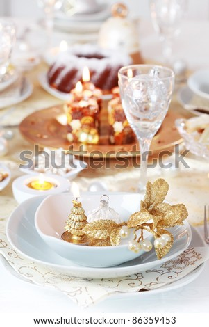 Place setting for Christmas in golden and white tone