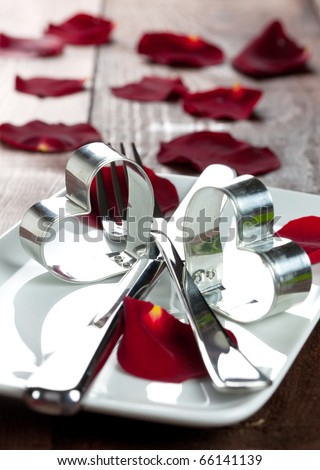 place setting for valentines day with petals