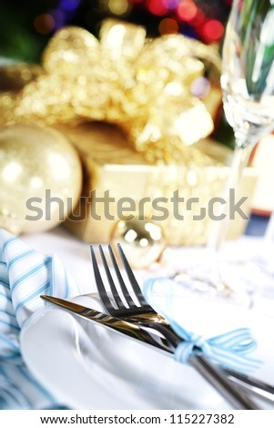 place setting on Christmas tree background