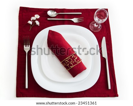 place setting on dark red isolated with clipping path