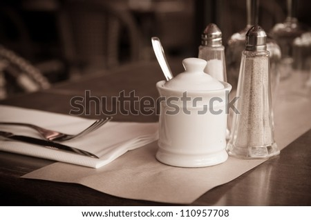 place setting - plate, knife and fork on table