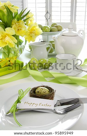 Place setting with card and flowers for easter brunch