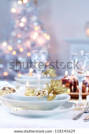 Place setting with Christmas tree in background
