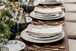 Place setting with menu and name card at elegant shabby chic table