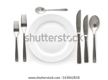 Place setting with plate, knife and fork. on white background