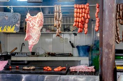 Place where pork, sausages and types of meats are sold. And they instantly prepare dishes with roast meats.