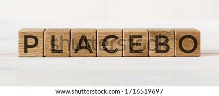 Placebo word written on blocks. Placebo effect, fake medical treatment ストックフォト ©