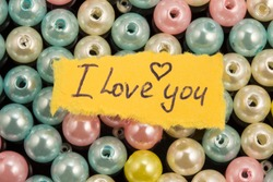 placer of multi-colored beads and the inscription i love you