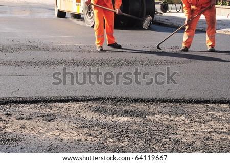 Placing asphalt on the road