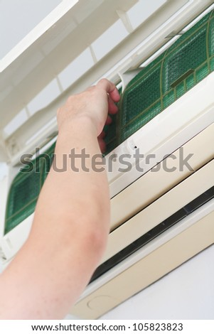 Placing back clean filter into air-conditioner