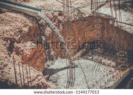 Placing concrete for the footing. image vintage style