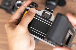 Placing photographic roll in a camera