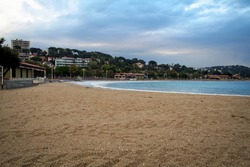 Plage du Mourillon beach, deserted, during a rainy cloudy afternoon. Mourillon is one of the main beaches of the city of Toulon, France, on the French riviera.