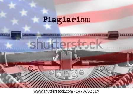 Plagiarism text typed on an old typewriter. America flag background. US. Copyright, copying of ideas. Close-up