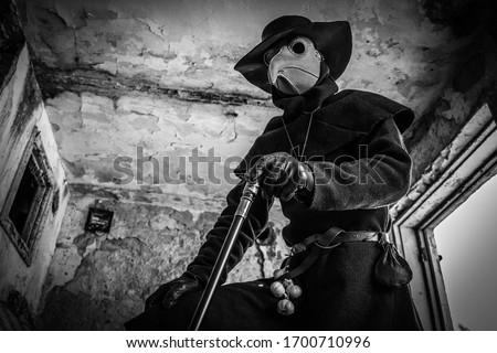 Plague doktor and plague and death. Stockfoto ©