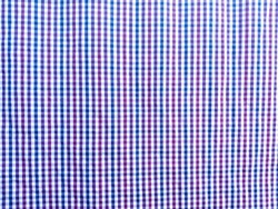 Plaid fabric combination of red, navy and white. Plaid fabric background.