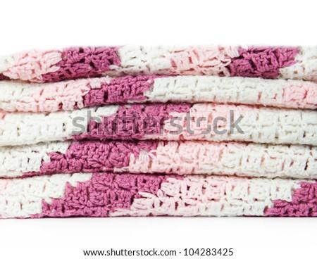 plaid lies a pile on a white background