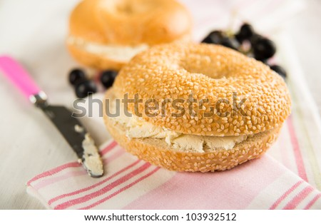 Plain ans Sesame Seed Bagels with Cream Cheese and Grapes