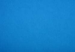 Plain blue background. Blue cardboard. Blue paper texture background. Abstract geometric flat composition. Copy spaces