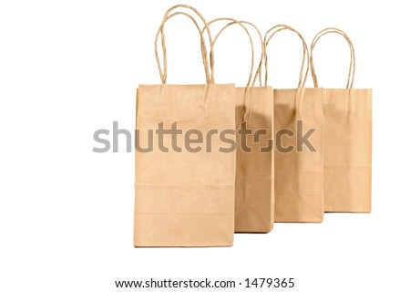 Plain brown bags, lined up, with space for copy - stock photo