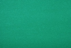 Plain green background. Green cardboard. Green paper texture background. Abstract geometric flat composition. Copy spaces