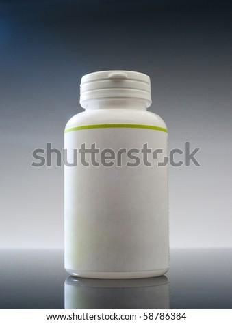 Plain plastic medicine container on white background - stock photo